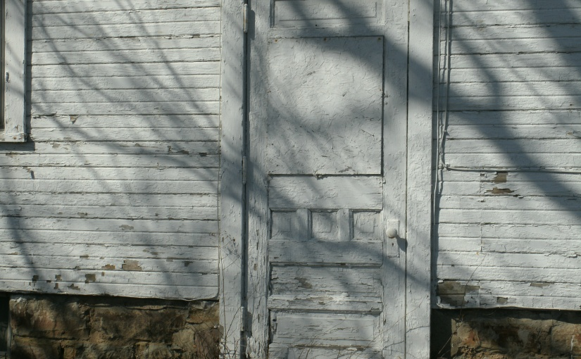 Last Rays of February Reflect Upon a Doorway to thePast