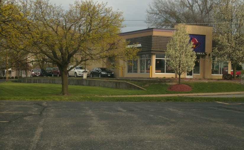 Our Local Taco Bell – Framed by Spring-Flowering Trees – a Symbol of Responsible COVID-19Practices